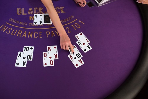 online casino blackjack table with cards and a croupier