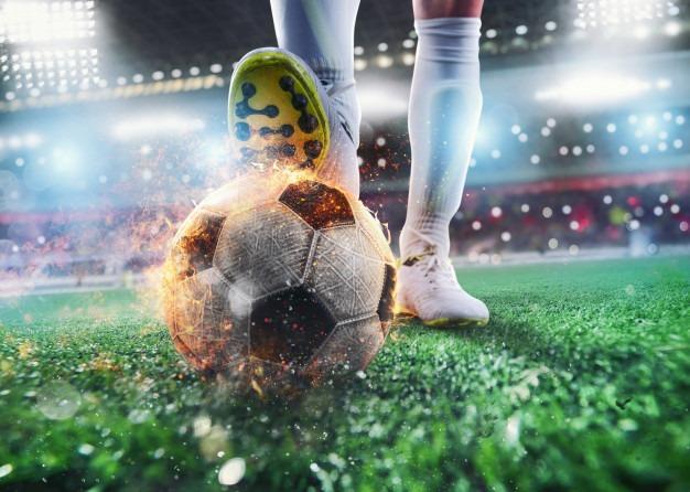 close-up-soccer-striker-ready-kicks-fiery-ball-stadium_207634-7